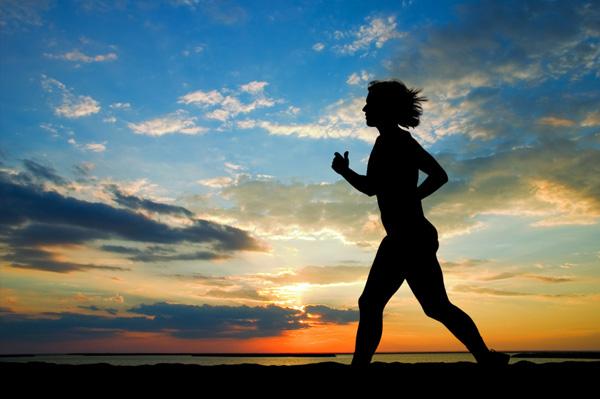 Woman-running-at-sunset